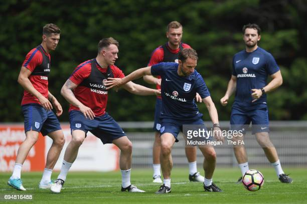 England manager Gareth Southgate in action with John Stones Phil Jones and Ben Gibson during the England training session at Stade Omnisports on June...