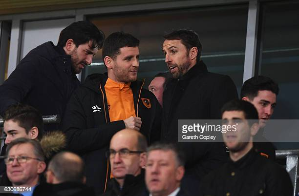 England manager Gareth Southgate talks with Alex Bruce of Hull City as he attends the Premier League match between Hull City and Everton at KCOM...