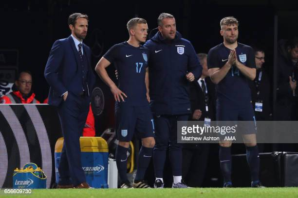 England Manager / Head Coach Gareth Southgate looks on as James WardProwse and Luke Shaw wait to come on as subs during the international friendly...
