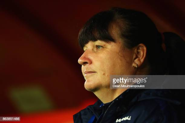 England Manager / Head coach Mo Marley looks on prior to the International friendly match between France and England held at Stade du Hainaut on...