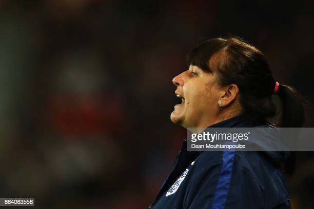 England Manager / Head coach Mo Marley signals to her players during the International friendly match between France and England held at Stade du...