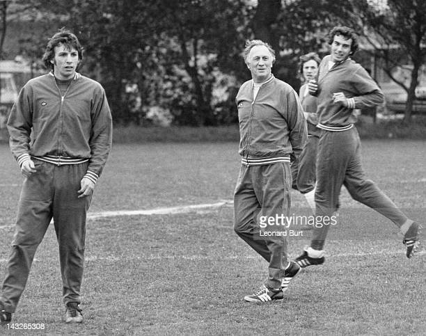 England manager Joe Mercer at his first training session with the national team at Roehampton 10th May 1974 With him are players Martin Peters and...