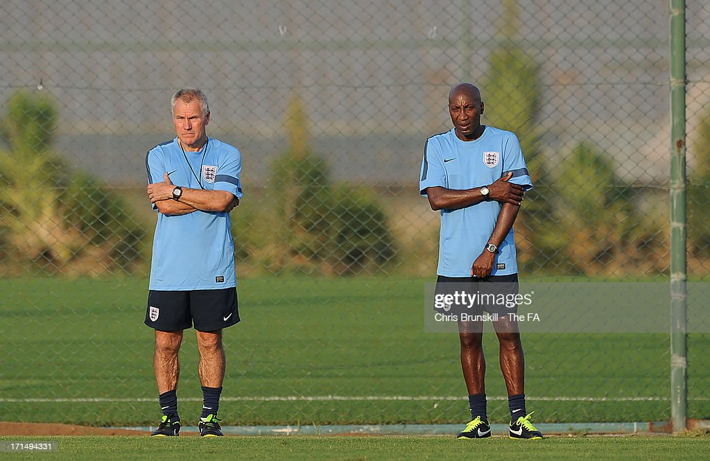 England manager Peter Taylor (L) looks on next to his assistant Chris Ramsay during England Training on June 25, 2013 in Antalya, Turkey.