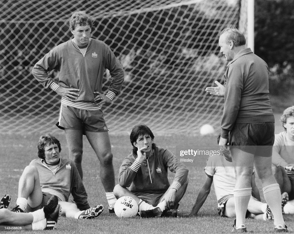 England manager Ron Greenwood (1921 - 2006, right) talks to members of the team at a training session at London Colney, near St. Albans, 8th September 1980. Left to right: Eric Gates, Terry Butcher, Paul Mariner and Greenwood.