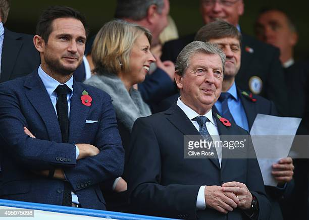England manager Roy Hodgson and former Chelsea player Frank Lampard are seen on the stand during the Barclays Premier League match between Chelsea...
