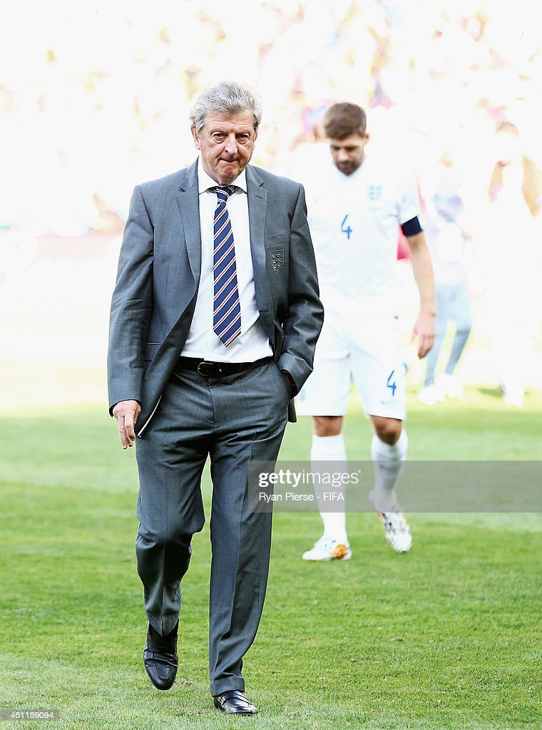 England manager <a gi-track='captionPersonalityLinkClicked' href=/galleries/search?phrase=Roy+Hodgson&family=editorial&specificpeople=881703 ng-click='$event.stopPropagation()'>Roy Hodgson</a> and <a gi-track='captionPersonalityLinkClicked' href=/galleries/search?phrase=Steven+Gerrard&family=editorial&specificpeople=202052 ng-click='$event.stopPropagation()'>Steven Gerrard</a> of England leave the pitch after after a 0-0 draw during the 2014 FIFA World Cup Brazil Group D match between Costa Rica and England at Estadio Mineirao on June 24, 2014 in Belo Horizonte, Brazil.