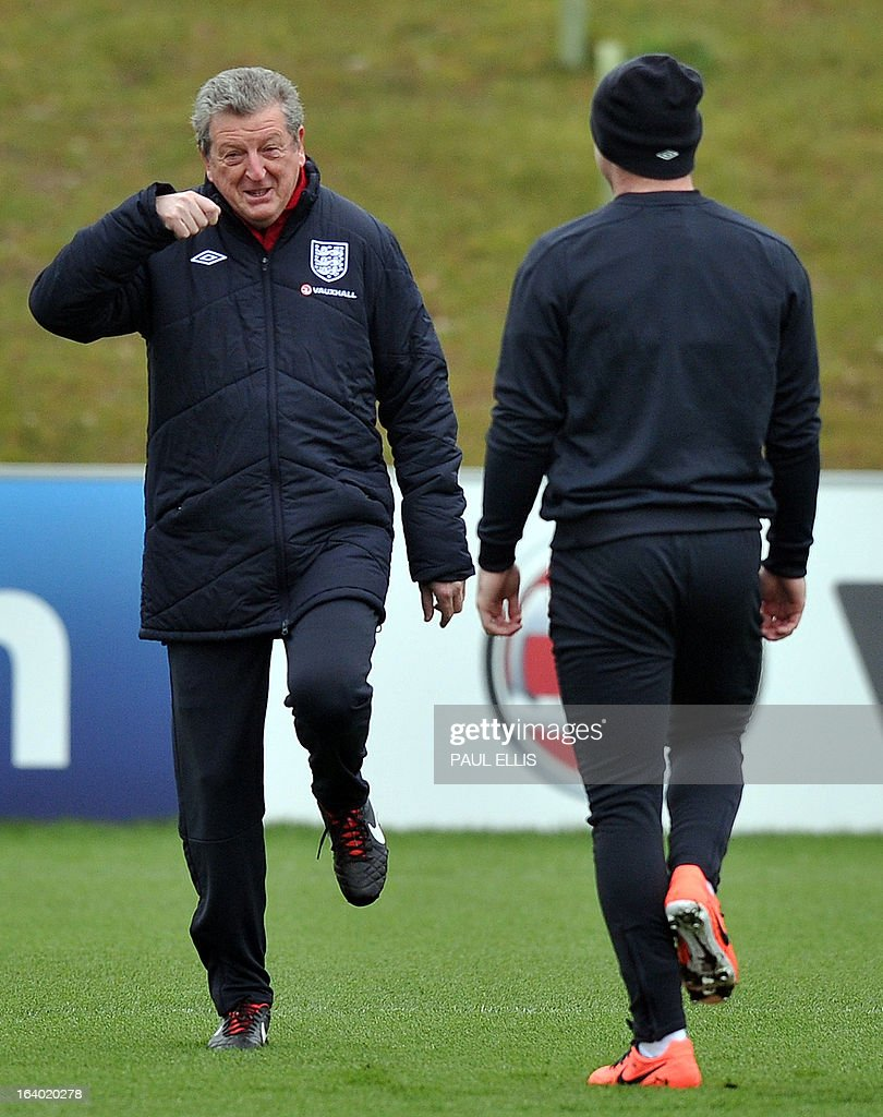 England manager Roy Hodgson (L) and striker Wayne Rooney (R) attend a training session at the St George's Park training complex, near Burton-upon-Trent, central England on March 19, 2013 ahead of their 2014 World Cup qualifier football match against San Marino on March 22. AFP PHOTO / PAUL ELLIS NOT FOR MARKETING OR ADVERTISING USE / RESTRICTED TO EDITORIAL USE