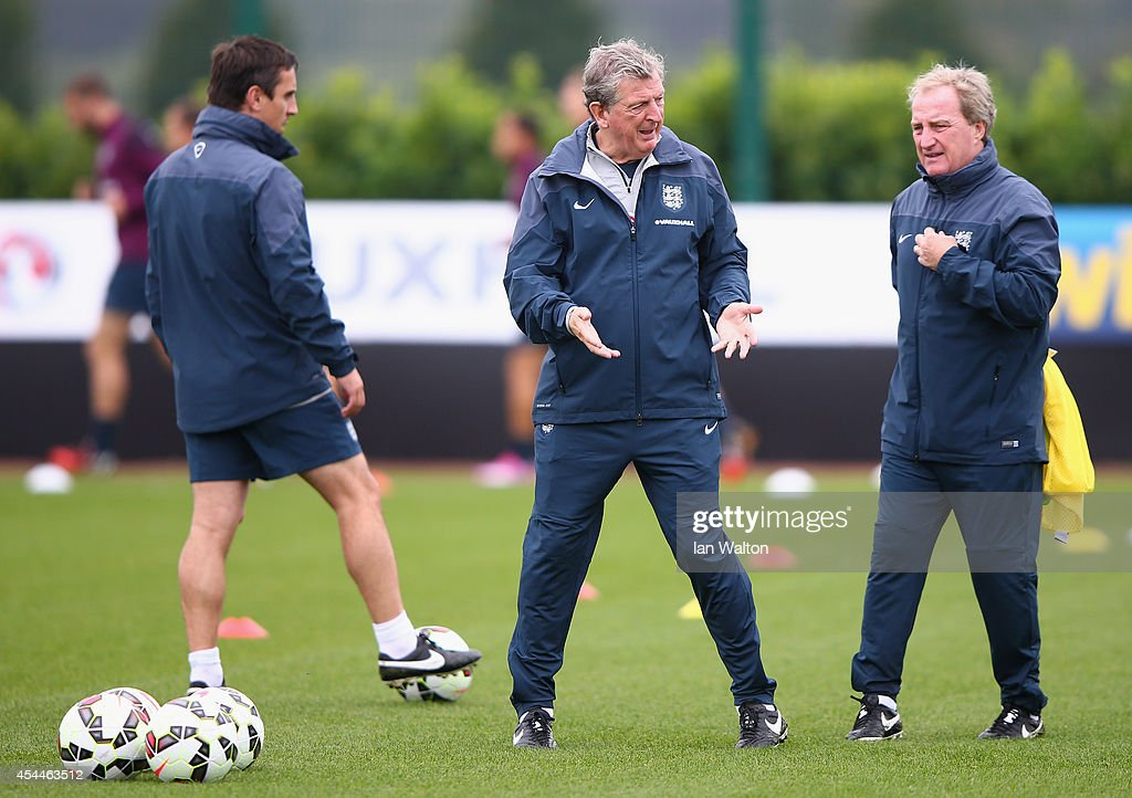 England manager <a gi-track='captionPersonalityLinkClicked' href=/galleries/search?phrase=Roy+Hodgson&family=editorial&specificpeople=881703 ng-click='$event.stopPropagation()'>Roy Hodgson</a>, assistant Ray Lewington and coach Gary Neville conduct an England training session before there international friendly match against Norway at London Colney on September 1, 2014 in London, England.