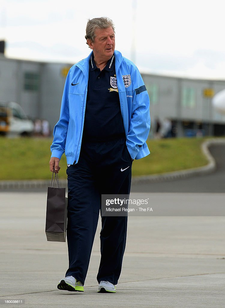 England Manager <a gi-track='captionPersonalityLinkClicked' href=/galleries/search?phrase=Roy+Hodgson&family=editorial&specificpeople=881703 ng-click='$event.stopPropagation()'>Roy Hodgson</a> boards the plane to Kiev after the England press conference at Luton Airport on September 8, 2013 in Hertford, England.