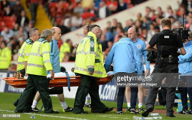England manager Roy Hodgson checks on the welfare of Nathaniel Chalobah after he is stretchered off the pitch after picking up an injury