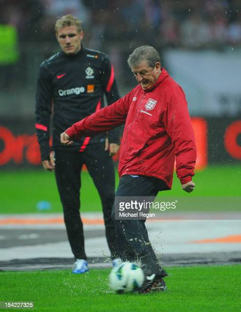 England manager Roy Hodgson kicks a ball on the rain sodden pitch before the FIFA 2014 World Cup Qualifier between Poland and England at the National...
