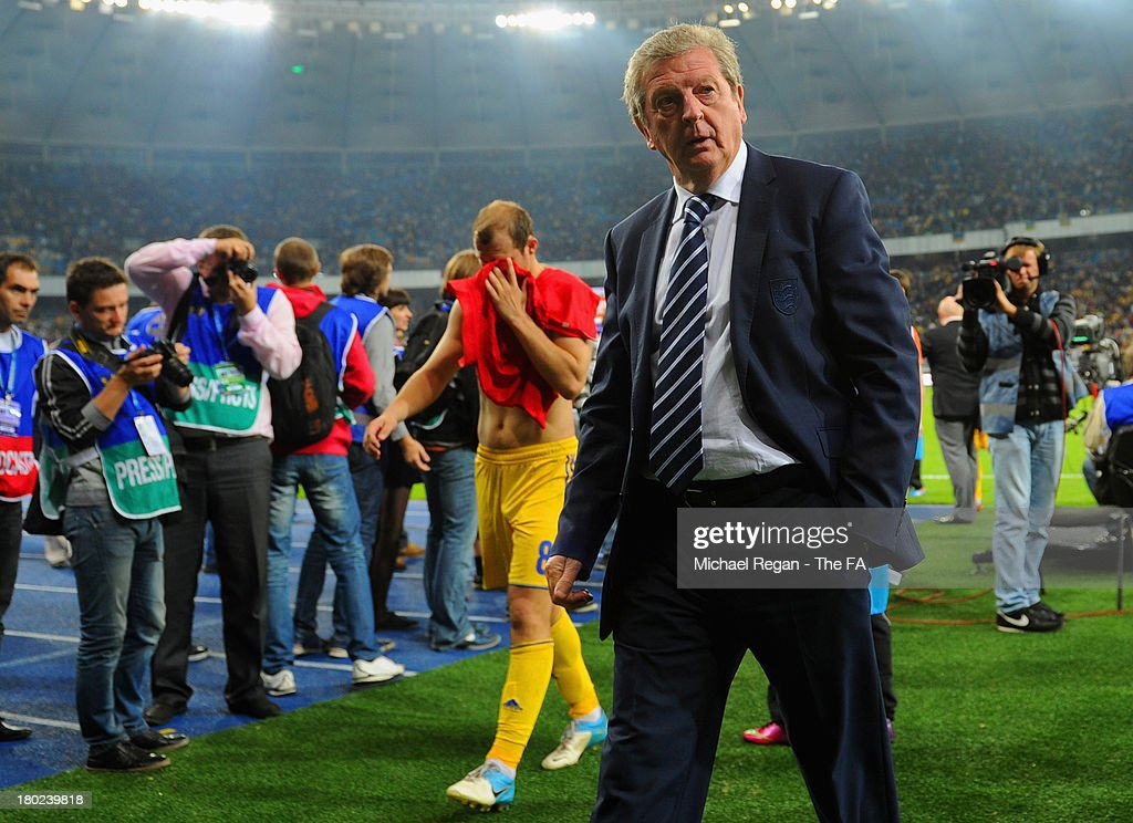 England manager <a gi-track='captionPersonalityLinkClicked' href=/galleries/search?phrase=Roy+Hodgson&family=editorial&specificpeople=881703 ng-click='$event.stopPropagation()'>Roy Hodgson</a> looks on as Roman Zozulya of Ukraine looks dejected after the FIFA 2014 World Cup qualifier at the Olympic Stadium on September 10, 2013 in Kiev, Ukraine.