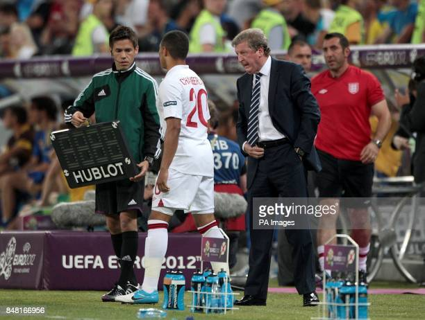 England manager Roy Hodgson passes on instructions to Alex OxladeChamberlain on the touchline