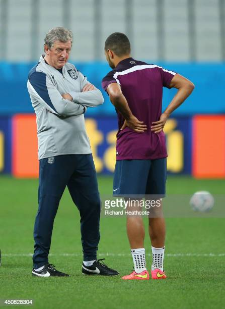 England Manager Roy Hodgson speaks to Alex OxladeChamberlain during an England training session ahead of the 2014 FIFA World Cup Brazil match against...