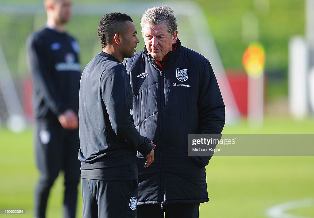 England manager Roy Hodgson speaks to Ashley Cole during the Engand training session at St Georges Park on February 4, 2013 in Burton-upon-Trent, England.