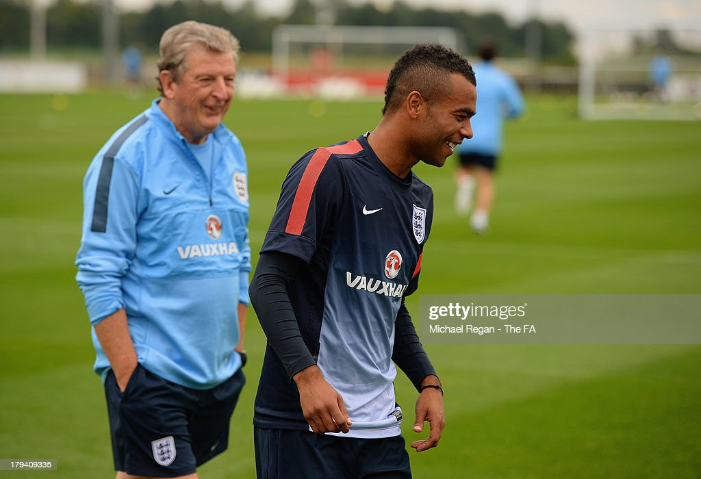 England manager Roy Hodgson speaks to Ashley Cole during the England training session and press conference at St Georges Park on September 3, 2013 in Burton-upon-Trent, England.