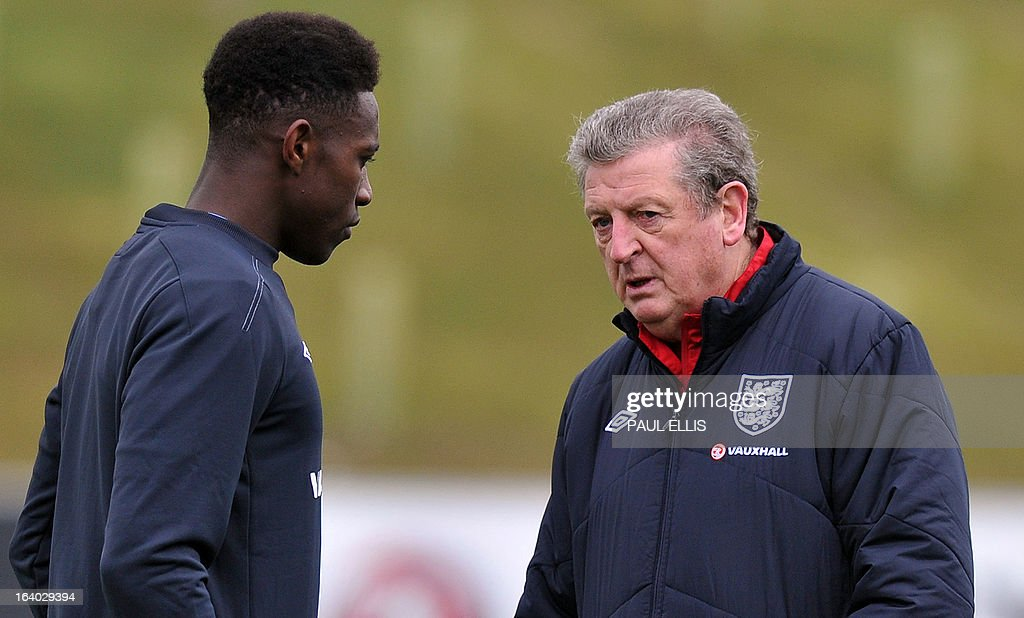 England manager Roy Hodgson (R) speaks to striker Danny Welbeck (L) during a training session at the St George's Park training complex, near Burton-upon-Trent, central England on March 19, 2013 ahead of their 2014 World Cup qualifier football match against San Marino on March 22.