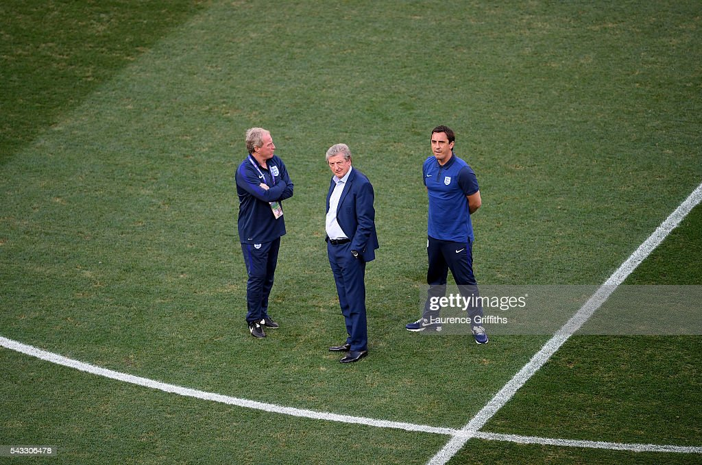 England manager Roy Hodgson (c) speaks with his assistant coaches Ray Lewington (l) and Gary Neville (r) prior to kickoff during the UEFA EURO 2016 round of 16 match between England and Iceland at Allianz Riviera Stadium on June 27, 2016 in Nice, France.