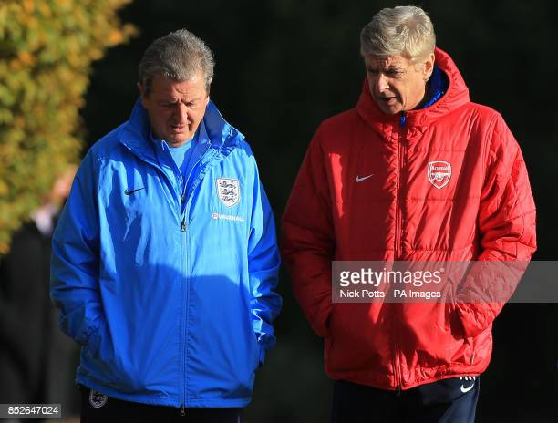 England Manager Roy Hodgson talks with Arsenal Manager Arsene Wenger before the both take their teams training session during a training session at...