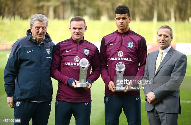 England manager Roy Hodgson Wayne Rooney Dominic Solanke and Vauxhall's Keith Michaels pose during the presentation of England Player of the Year and...
