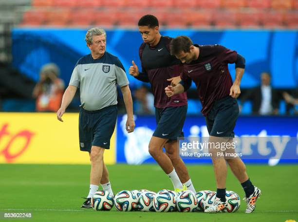 England manager Roy Hodgson with Chris Smalling and Frank Lampard during a training session at the Arena da Amazonia Manaus Brazil