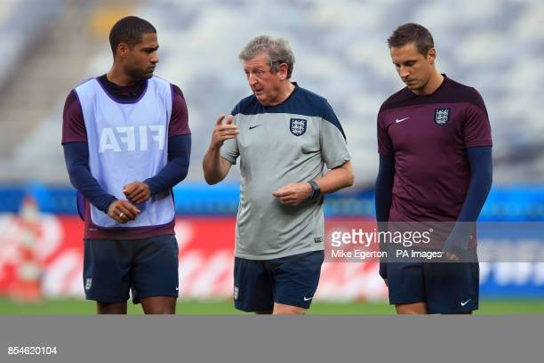 England manager Roy Hodgson with Glen Johnson and Phil Jagielka during a training session at the Estadio Mineirao Belo Horizonte Brazil