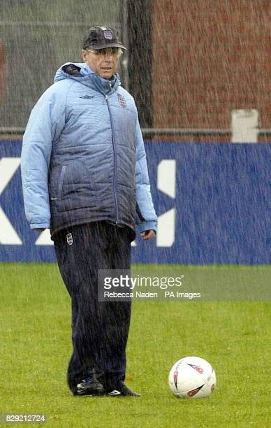 England manager Sven Goran Eriksson stands drenched in the rain during a team training session at Southampton FC training ground Staplewood Near...