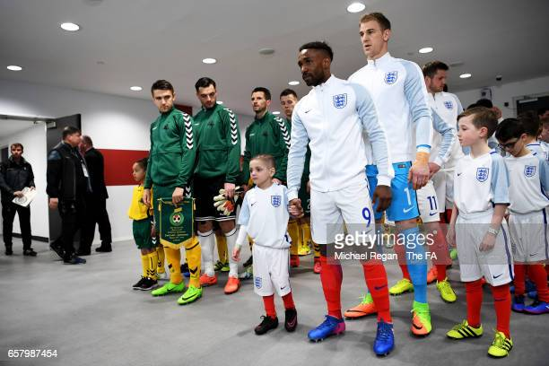England mascot Bradley Lowery is walked out onto the pitch by Jermain Defoe of England during the FIFA 2018 World Cup Qualifier between England and...