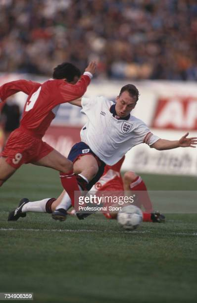 England midfielder and captain of the national team David Platt is tackled by Turkish midfielder Mehmet Ozdilek during play in the FIFA World Cup...