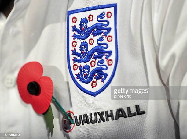 England midfielder Frank Lampard wearts a poppy for Armistice Day on his shirt as he speaks during a press conference ahead of England's forthcoming...