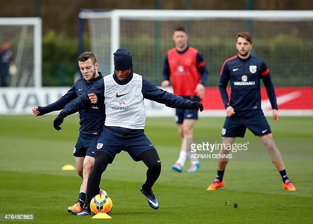 England midfielder Jack Wilshere vies for the ball against striker Daniel Sturridge during a training session at Tottenham Hotspur's training complex...
