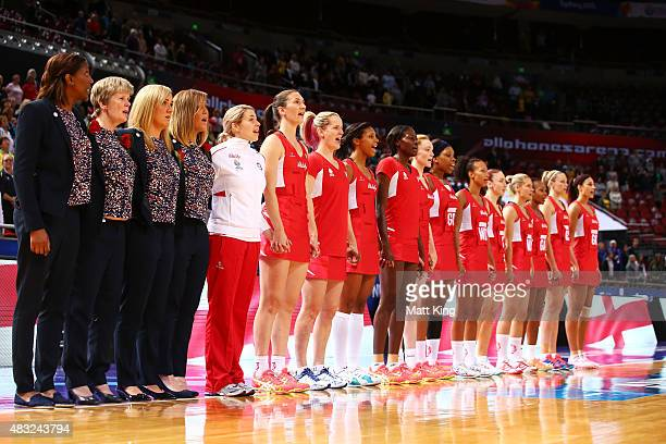 England netball head coach Tracey Neville and the England team line up for their national anthem during the 2015 Netball World Cup match between...