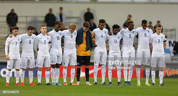 England observe a minutes silence in memory of those who died in the Paris terrorist attack prior to the U19 International friendly match between...