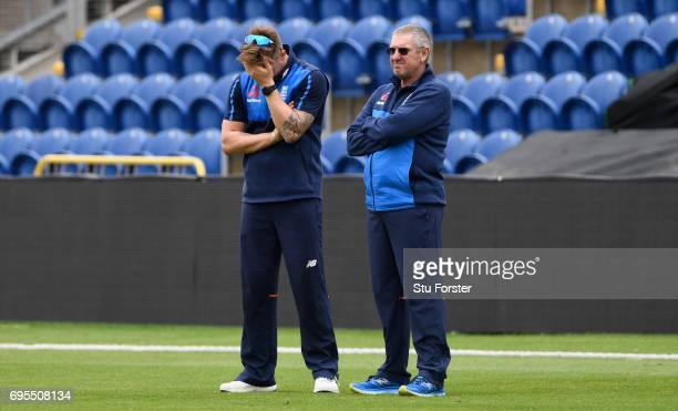 England opener Jason Roy reacts as he talks to coach Trevor Bayliss during England nets ahead of their ICC Champions Trophy match against Pakistan at...