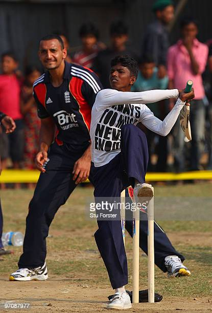 England player Ajmal Shahzad keeps wicket as a boy plays a shot during a game of cricket during a visit by England players to promote the World...