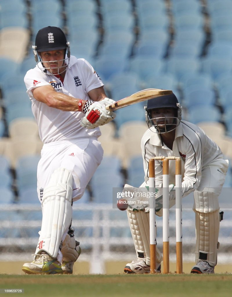 England player batsman Nick Compton plays a shot during the final day of a three day practice cricket match between Mumbai 'A' and England at D.Y. Patil Stadium on November 5, 2012 in Mumbai, India.