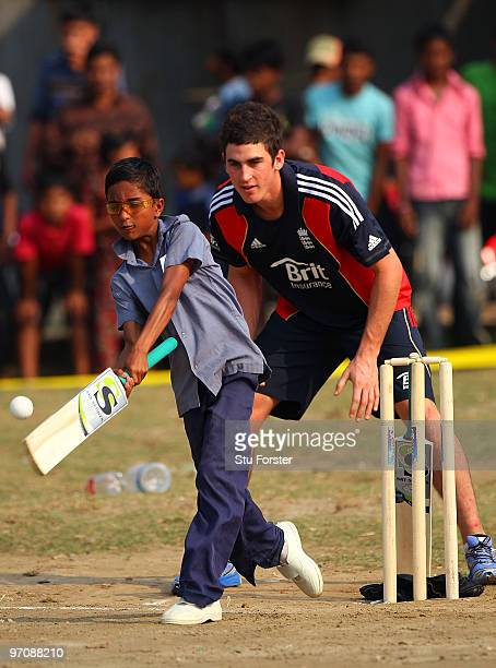 England player Craig Kieswetter keeps wicket as a schoolboy plays a shot during a game of cricket during a visit by England players to promote the...