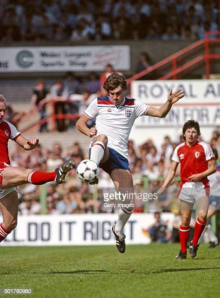 England player Glenn Hoddle in action against Wales at the Racecourse Ground during a Home International match between Wales and England on May 17...