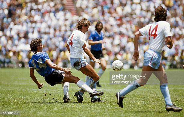 England player Glenn Hoddle is challenged by Ricardo Giusti of Argentina during the 1986 FIFA World Cup quarter final match between England and...