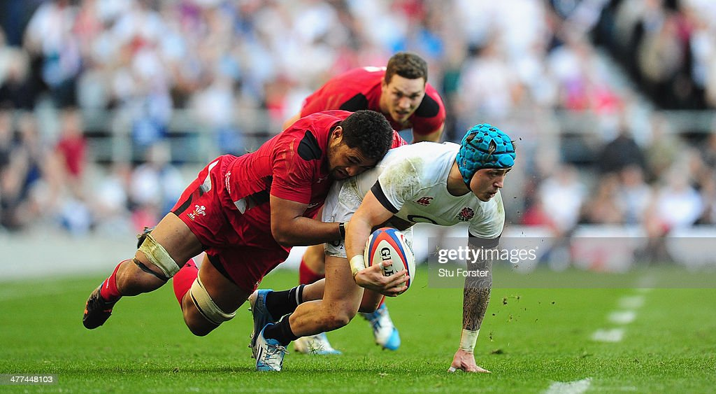 England player <a gi-track='captionPersonalityLinkClicked' href=/galleries/search?phrase=Jack+Nowell&family=editorial&specificpeople=7377985 ng-click='$event.stopPropagation()'>Jack Nowell</a> is tackled by Toby Faletau (l) during the RBS Six Nations match between England and Wales at Twickenham Stadium on March 9, 2014 in London, England.