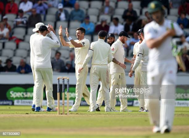 England player James Anderson celebrates the dismissal of South Africa's captain Faf du Plessis on day 4 of the fourth Test match between England and...