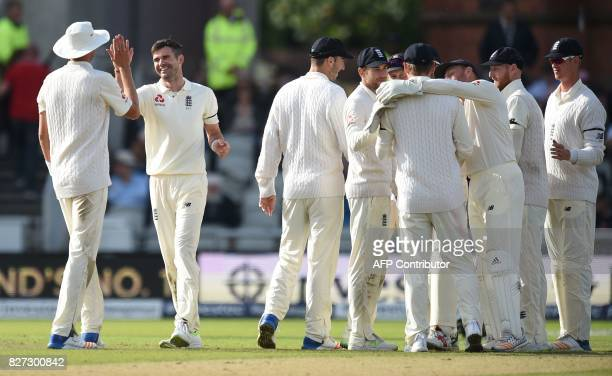 England player James Anderson celebrates the dismissal of South Africa's Kagiso Rabada on day 4 of the fourth Test match between England and South...