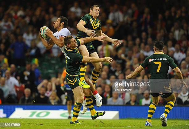 England player Leroy Cudjoe outjumps the Australia defence to score the second England try during the Rugby League World Cup Group A match between...
