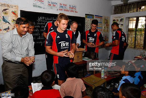 England player Luke Wright hands out buiscuits to school children during a visit by England players to promote the World Feeding Programme in...