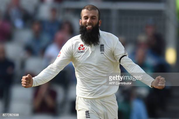 England player Moeen Ali celebrates the dismissal of South Africa's batsman Theunis de Bruyn on day 4 of the fourth Test match between England and...