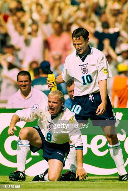 England player Paul Gascoigne emerges from his 'Dentists Chair' celebration whilst Teddy Sheringham looks on after scoring the second goal in the...