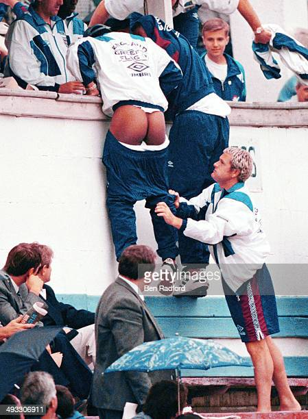 England player Paul Gascoigne pulls down the track suit trousers of team mate Paul Ince during the Moldova v England U21's match on September 31 1996...