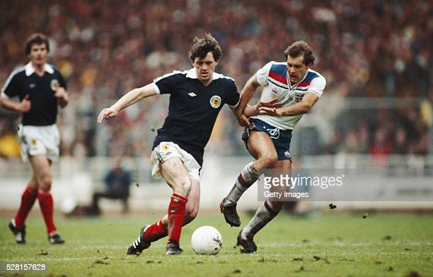 England player Ray Wilkins challenges David Narey of Scotland during a British Championships match at Wembley Stadium on May 23 1981 in London England