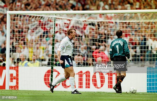 England player Stuart Pearce celebrates after scoring his shoot out penalty past Spain goalkeeper Andoni Zubizarreta during the 1996 European...