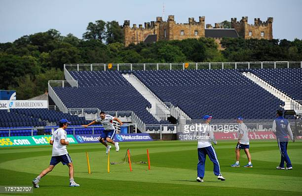 England player Tim Bresnan and team mates warm up in the shadow of Lumley Castle during England practice at Emirates Durham ICG on August 7 2013 in...